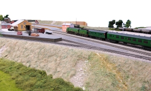 35023 sweeps into Little Bytham station. At this stage a lot of the buildings are just mock ups.