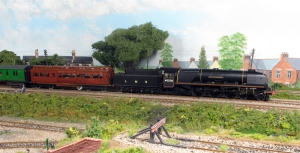 Ex LMS City of Bradford Heads past Fisherton Sarum onm an Exteter to Waterloo working. Note the WD tender fitted due to lack of water troughs on the SR.