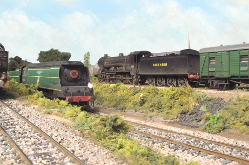 Drummond T14 class 461 heads South West with a stopper service to Yeovil passing Bulleid Light Pacific Battle of Britain class s21C159 'Sir Archibold Sinclair' on the rear 'Windsor Castle' coaling line on shed