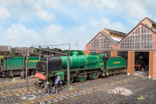 N Class 1854, one of two that received malachite green livery after the war, simmers in front of the shed.