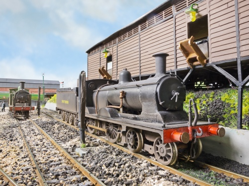 """A Drummond 4-4-0 L11 """"Large Hopper"""" No 405 is being coaled and watered. She has been built from Lodden etched brass kit.The LSWR style water column is scratchbuilt from brass tube"""