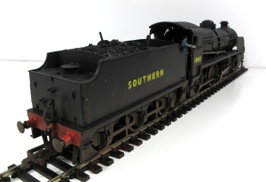 a rear 3/4 view of 1848, Real coal has been added to the tender along with crew.