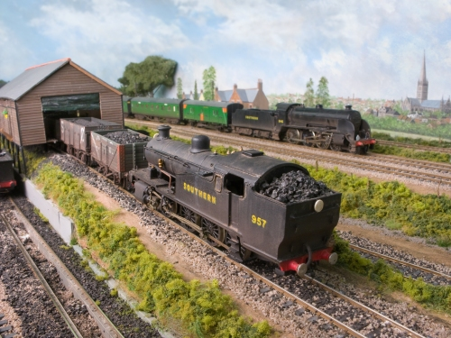 Z Class number 957 pushes loaded coal wagons up the coal stage ramp, whilst S15 No. 846, built from a DJH kit passes by on a local stopping passenger