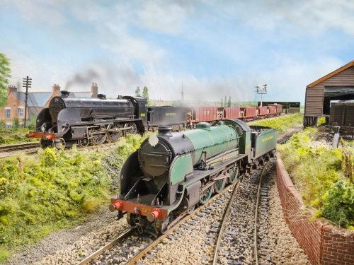 N15 class s747 in early British Railways livery backs towards the coaling stage, whilst S15 Class No. 846 heads west on a ballast train of Dia 1774 40T hoppers that are modified Lima models