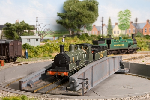 Adams A12 Jubilee class, built from a Nu-Cast kit,  is turned at Fisheton Sarum with a Drummond M7 in the background.