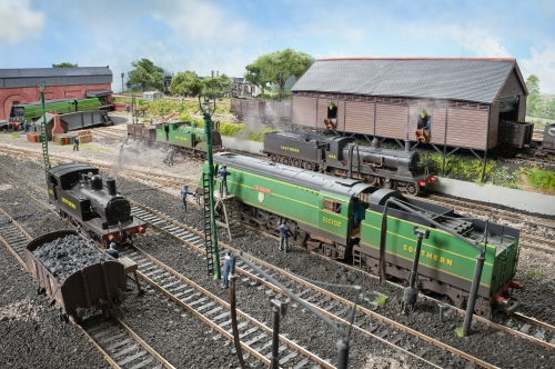 """A quiet period on shed with Bulleid pacific 21C102 """"Salisbury"""" being cleaned, a modified Hornby fitted with original style cab and short smoke deflectors. A Drummond 4-4-0 L11 """"Large Hopper"""" No 405 is being coaled. She has been built from Lodden etched brass kit. An Adams 0-4-4T O2 No 213 also simmers on shed."""