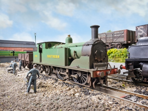 Drummond 0-4-4T M7 No. 243 is one of the 6 painted in Malachite Green after the war but is one of those that were unlined, she is a repainted Hornby model. She has just shunted the ash wagon for filling by the gang.