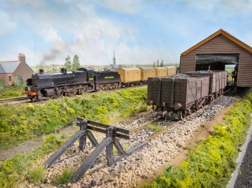 Maunsell 2-6-0 N1 class 1822 heads west on a freight service. 1822 has been converted from a Bachmann N Class with modified front end and valve gear. The first four wagons are banana vans piped with steam heating to help ripen the fruit.