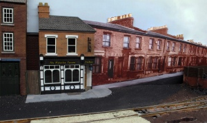 The final image cut cutout in place on the layout next to the low relief public house